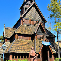 Stave Church in Norway at Epcot in Orlando, Florida<br /> This portion of the Norway Pavilion is a replica of the wooden architecture once common among Christian churches in Scandinavia.  During the style&rsquo;s peak, Norway had about 2,000 stave churches.  28 of them, dating from the 12th through 14th centuries, have been lovingly maintained in Norway. Standing guard is a Viking warrior.  These Norsemen were legendary seafarers during the late 8th through the 11th centuries.