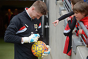 MK Dons Goalkepper Charlie Burns signs autographs during the Sky Bet Championship match between Milton Keynes Dons and Brentford at stadium:mk, Milton Keynes, England on 23 April 2016. Photo by Dennis Goodwin.