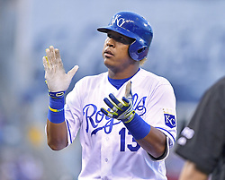 April 13, 2017 - Kansas City, MO, USA - The Kansas City Royals' Salvador Perez applauds at first after his RBI single in the first inning against the Oakland Athletics at Kauffman Stadium in Kansas City, Mo., on Thursday, April 13, 2017. (Credit Image: © John Sleezer/TNS via ZUMA Wire)