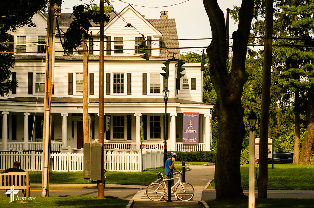 A man rides his bike in front of Stein Hall-Conservatory at Concordia College New York on Friday, July 18, 2014, in Bronxville, NY. LCMS Communications/Erik M. Lunsford