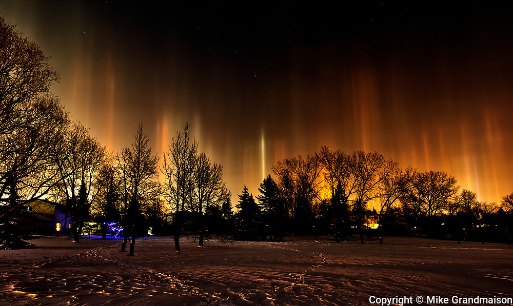 Light pillars originating from artificial light sources. Southdale Neighbourhood. <br />