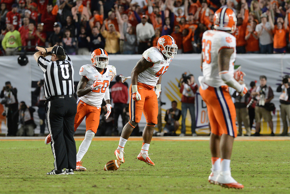 January 3, 2014: Stephone Anthony #42 of Clemson celebrates after intercepting a pass during the NCAA football game between the Clemson Tigers and the Ohio State Buckeyes at the 2014 Orange Bowl in Miami Gardens, Florida. The Tigers defeated the Buckeyes 40-35.