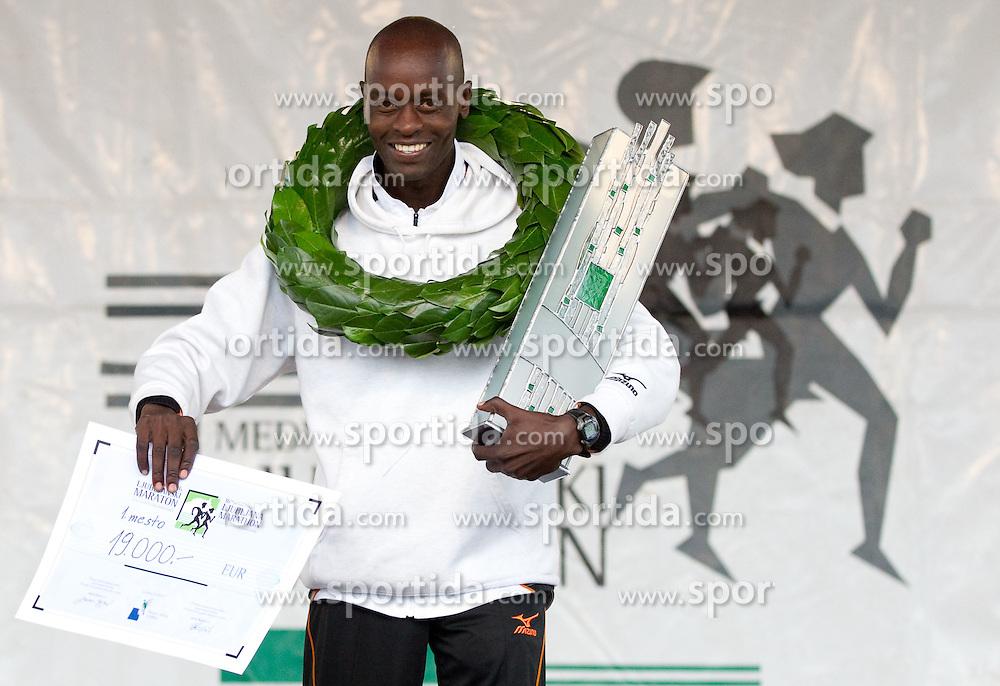 Winner Daniel Too of Kenya celebrates during medal ceremony at 16th International Ljubljana Marathon 2011 on October 23, 2011, in Trg republike, Ljubljana, Slovenia.  (Photo by Vid Ponikvar / Sportida)