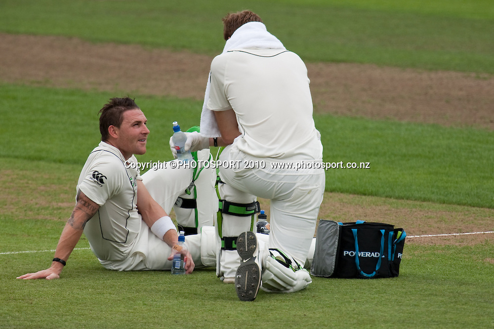 Brendon McCullum and martin Guptill take a drinks break during day 2 of the one off test cricket match between New Zealand Black Caps and Bangladesh at Seddon Park, Hamilton, New Zealand, Tuesday 16 February 2010. Photo: Stephen Barker/PHOTOSPORT