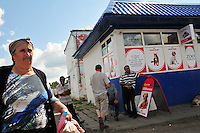 """Vendors are in no hurry at an local market in Uglich, Russia. As one of Russia's """"Golden Ring"""" cities, Uglich is designated a town of significant cultural importance."""