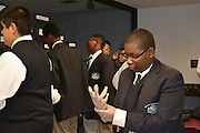 Mickey Leland ninth-grade biology students don protective gloves before entering the Health Museum's DeBakey Cell Lab.