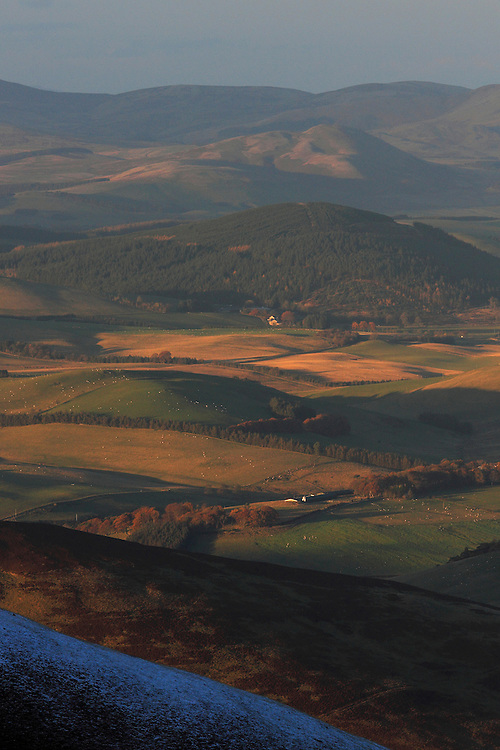 Last of the winters evening light over rolling hills to the west of Broughton in the Scottish Borders