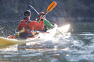 Two kayaks paddling backlight In-season Sandpoint Idaho.