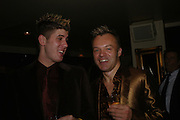 Kristian Seeber and Graham Norton. Opening night of Mary Poppins at the Prince Edward Theatre and party afterwards at 1 Leicester Sq. 15 December 2004. SUPPLIED FOR ONE-TIME USE ONLY> DO NOT ARCHIVE. © Copyright Photograph by Dafydd Jones 66 Stockwell Park Rd. London SW9 0DA Tel 020 7733 0108 www.dafjones.com