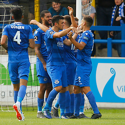 Team mates flock to congratulate Eastleighs forward Paul McCallum after scoring his sides second goal in the first half during the National League match between Dover Athletic FC and Eastleigh FC at Crabble Stadium, Kent on 25 August 2018. Photo by Matt Bristow.