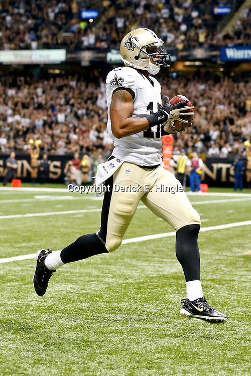 Sep 22, 2013; New Orleans, LA, USA; New Orleans Saints wide receiver Robert Meachem (17) catches a touchdown over Arizona Cardinals cornerback Jerraud Powers (not pictured) during a game at Mercedes-Benz Superdome. The Saints defeated the Cardinals 31-7. Mandatory Credit: Derick E. Hingle-USA TODAY Sports