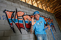Rob VanWinkle poses inside his rebuild house.  as seen on The Vanilla Ice Project. (portrait)