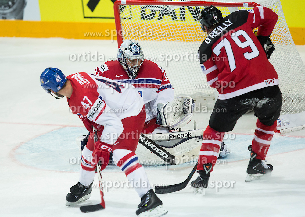 Ryan O'Reilly of Canada vs Michal Jordan of Czech Republic and Ondrej Pavelec of Czech Republic during Ice Hockey match between Canada and Czech Republic at Semifinals of 2015 IIHF World Championship, on May 16, 2015 in O2 Arena, Prague, Czech Republic. Photo by Vid Ponikvar / Sportida