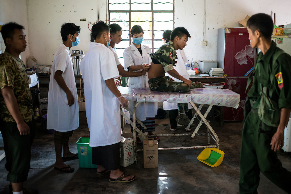 Laiza 20160915<br /> A K.I.A. rebell injured in a Burmese army shelling of Tsin Yu Bum, a mountain top with a frontline outpost, getting shrapnel taken out of his back at the army hospital in Laiza, Kachin State, Myanmar.<br /> Photo: Vilhelm Stokstad / Kontinent