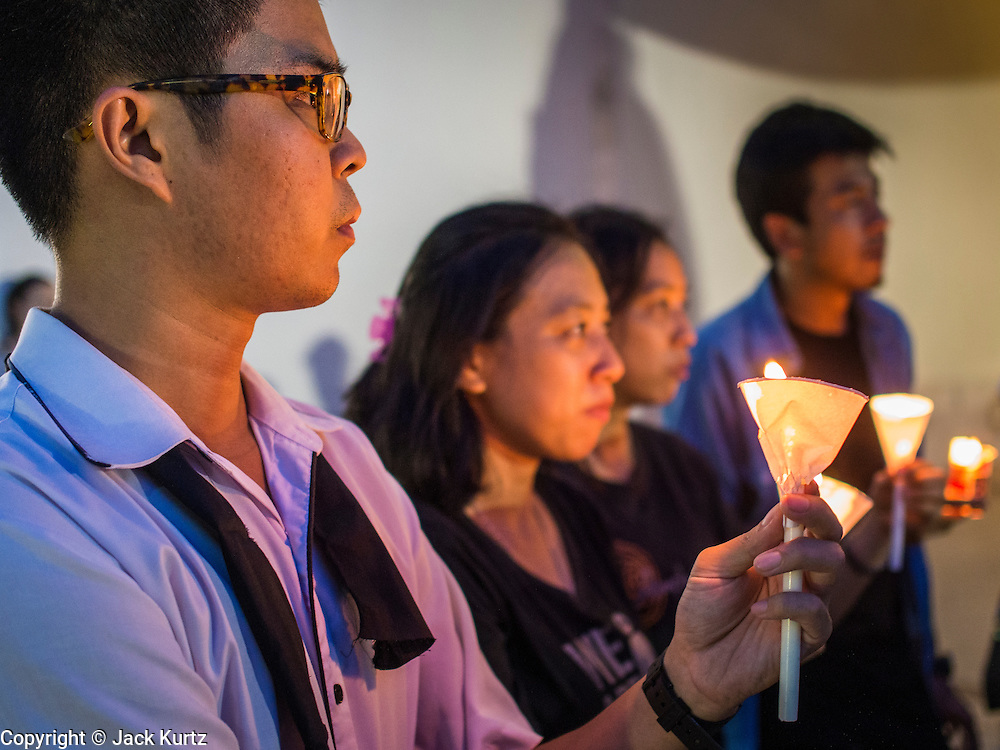 20 MAY 2014 - BANGKOK, THAILAND: Thais hold candles during a vigil against martial law. About 200 Thais gathered at the Bangkok Art and Culture Centre in central Bangkok to protest the army's decision to impose martial law.   PHOTO BY JACK KURTZ