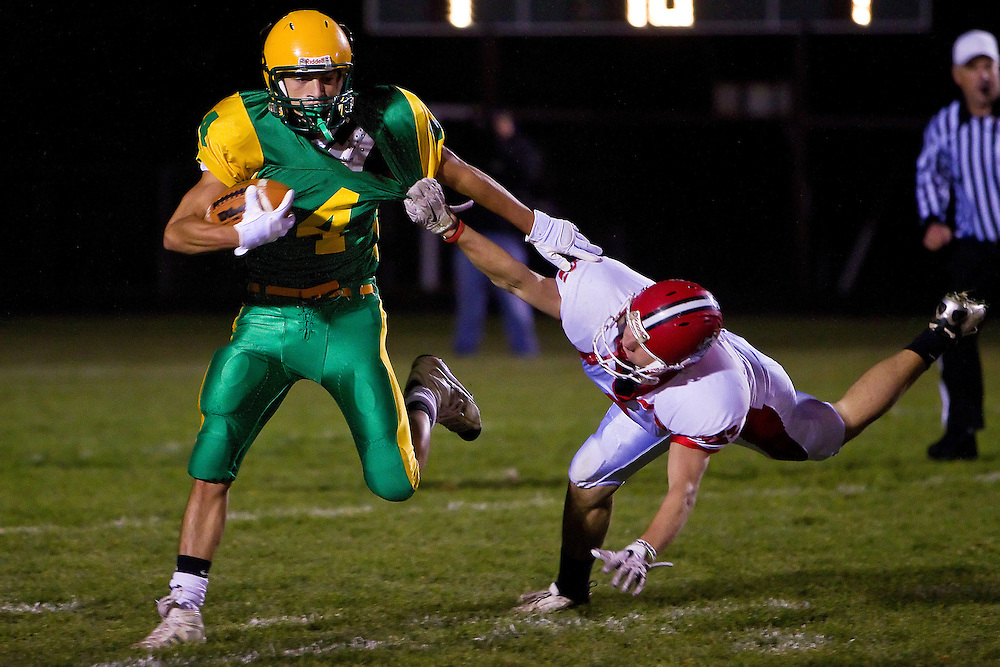Lakeland High receiver races toward a first down with a Sandpoint High defender tugging at his jersey.