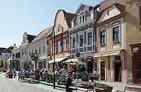 Historic buildings and cafe in the pedestrian area in the city of Koeszeg, Guens in Western Hungary.Historische Häuser und Cafe mit Gastgarten in der Fußgängerzone in der westungarischen Stadt Köszeg Güns, Ungarn