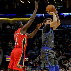 Dec 5, 2018; New Orleans, LA, USA; Dallas Mavericks forward Luka Doncic (77) shoots over New Orleans Pelicans guard Jrue Holiday (11) during the first quarter at the Smoothie King Center. Mandatory Credit: Derick E. Hingle-USA TODAY Sports