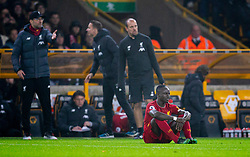 WOLVERHAMPTON, ENGLAND - Thursday, January 23, 2020: Liverpool's Sadio Mané goes down injured during the FA Premier League match between Wolverhampton Wanderers FC and Liverpool FC at Molineux Stadium. (Pic by David Rawcliffe/Propaganda)