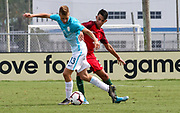 Slovenia midfielder Tom Kljun (13) and Portugal defender Gabriel Costa (4) fight for possession of the ball during a CONCACAF boys under-15 championship soccer game, Sunday, August 11, 2019, in Bradenton, Fla. Portugal defeated Slovenia in the final in 2-0. (Kim Hukari/Image of Sport)