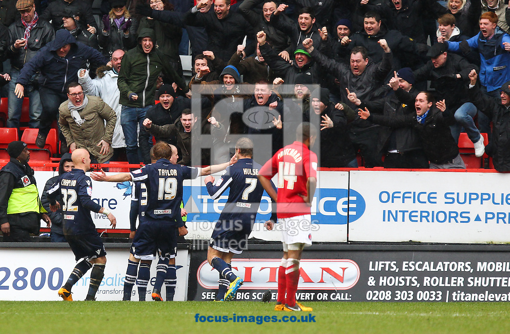 Picture by John  Rainford/Focus Images Ltd +44 7506 538356.16/03/2013.Millwall players celebrate the opening goal in front of their fans during the npower Championship match at The Valley, London.