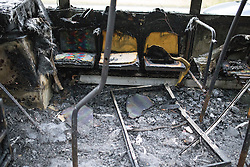© Licensed to London News Pictures . 25/09/2013 . Brighton , UK . The burned out remains of a Brighton-bound bus that caught fire minutes before the firefighters strike had ended , on the A23 this afternoon (25th September 2013) . The smoke filled road was closed to traffic causing large tailbacks . Photo credit : Joel Goodman/LNP