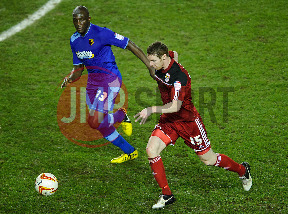 Watford Defender Nyron Nosworthy (JAM) challenges Bristol City Midfielder Stephen Pearson (SCO) during the first half of the match - Photo mandatory by-line: Rogan Thomson/JMP - Tel: Mobile: 07966 386802 29/01/2013 - SPORT - FOOTBALL - Ashton Gate - Bristol. Bristol City v Watford - npower Championship.