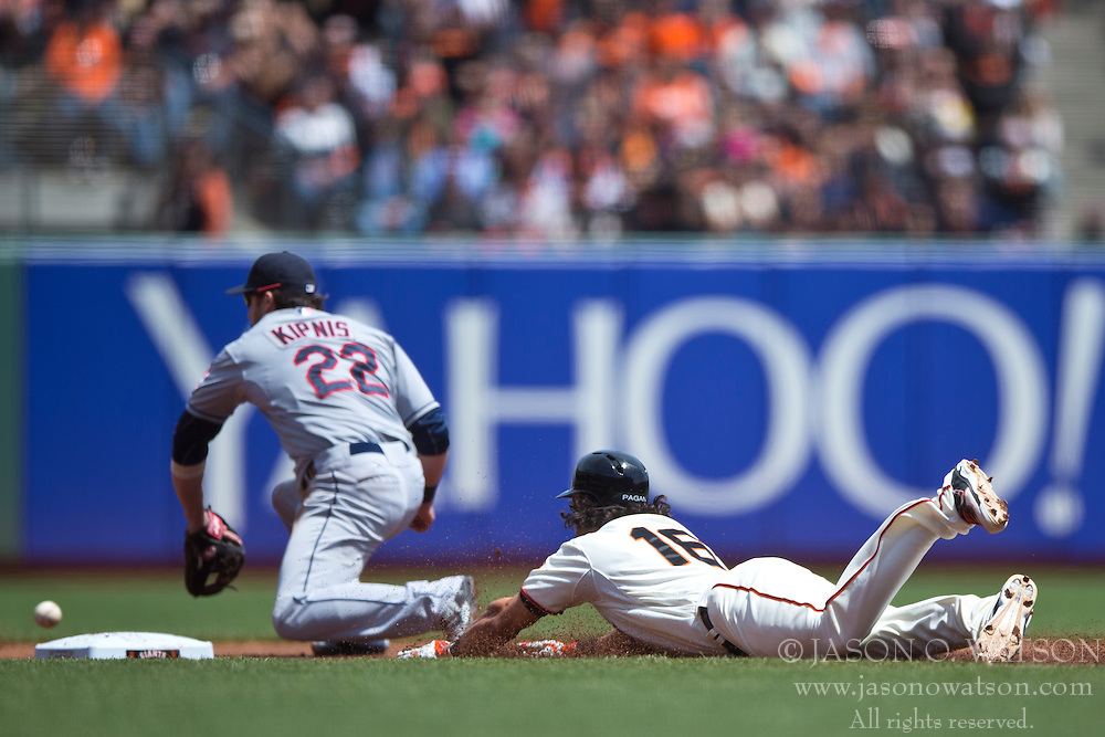 SAN FRANCISCO, CA - APRIL 26:  Angel Pagan #16 of the San Francisco Giants slides into second base for a double ahead of a tag from Jason Kipnis #22 of the Cleveland Indians during the first inning at AT&T Park on April 26, 2014 in San Francisco, California. The San Francisco Giants defeated the Cleveland Indians 5-3.  (Photo by Jason O. Watson/Getty Images) *** Local Caption *** Angel Pagan; Jason Kipnis