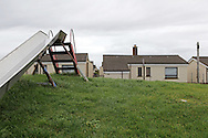 """Post-war prefabricated houses in Plasterfield, Stornoway, Isle of Lewis, Scotland. About 50 of them were built in 1947 as a response to the post-war housing shortage on Lewis. They were called the """"Isle of Lewis type""""."""