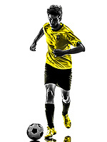 Paris, France - May 3,2013: one Brazilian soccer football player young man running in silhouette at Paris, France on May 3th 2013