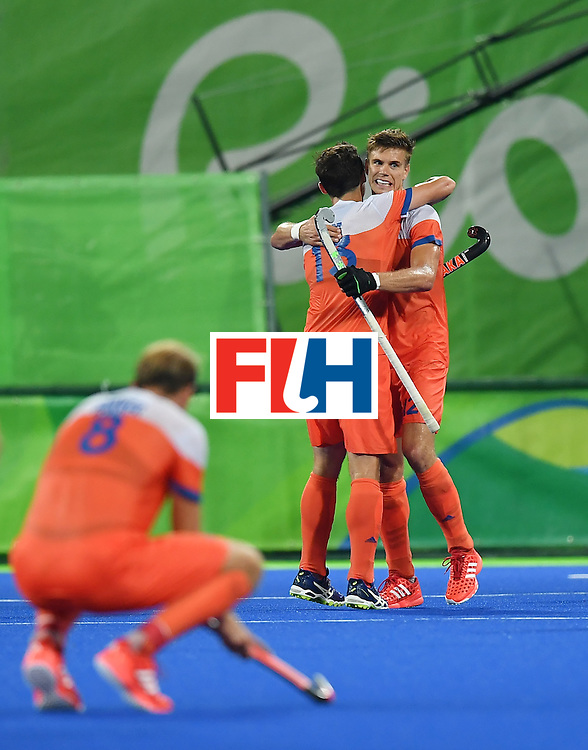 Netherland's Sander de Wijin (R) celebrates at the end of the men's quarterfinal field hockey Netherlands vs Australia match of the Rio 2016 Olympics Games at the Olympic Hockey Centre in Rio de Janeiro on August 14, 2016. / AFP / MANAN VATSYAYANA        (Photo credit should read MANAN VATSYAYANA/AFP/Getty Images)