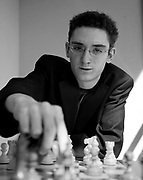 Lugano, il campione scacchista Fabiano Caruana. Fabiano Caruana was born on July 30, 1992 in Miami, Florida of an Italian-American father and an Italian mother. At the age of 4 his family relocated from Miami, Florida to Park Slope, Brooklyn. Coincidentally, this was the same neighborhood where Bobby Fischer lived during his youth. At age 5, his chess talent was discovered in an after school chess program at Congregation Beth Elohim in Park Slope, Brooklyn. That same year he played his first tournament at the Polgar Chess Center in Queens, New York.<br />