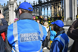Response pastors & floral tributes outside Parliament for the victims of the terrorist attack on 22 March 2017. Unite for Europe (anti Brexit) march to Parliament, a few days before Article 50 is due to be triggered.  London 25 March 2017 UK