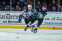 KELOWNA, CANADA - JANUARY 30:  Michael Farren #16 of the Kelowna Rockets stick checks Owen Williams #25 of the Seattle Thunderbirds as he passes the puck on January 30, 2019 at Prospera Place in Kelowna, British Columbia, Canada.  (Photo by Marissa Baecker/Shoot the Breeze)