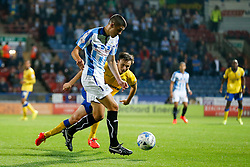 Conor Coady of Huddersfield is challenged by William Kvist of Wigan - Photo mandatory by-line: Rogan Thomson/JMP - 07966 386802 - 16/09/2014 - SPORT - FOOTBALL - Huddersfield, England - The John Smith's Stadium - Huddersfield Town v Wigan Athletic - Sky Bet Championship.