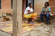 National director of UNICEF partner organization OIS Afrique, Molao Bomisso, (right) discusses with former FGM/C practitioner Josephine Akissi Coulibaly, 52, during a home visit in the town of Katiola, Cote d'Ivoire on Friday July 12, 2013. Josephine abandoned the practice thanks to advocacy work by OIS Afrique.