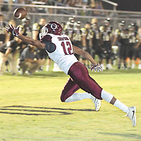 Okolina reciever Deshunta Thompson can't hang onto a pass deep in Falkner territory late in the second quarter on Friday.