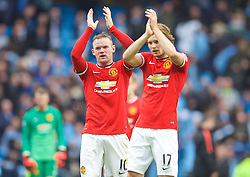 MANCHESTER, ENGLAND - Sunday, November 2, 2014: Manchester United's Wayne Rooney and Daley Blind look dejected as his side lose 1-0 to Manchester City during the Premier League match at the City of Manchester Stadium. (Pic by David Rawcliffe/Propaganda)