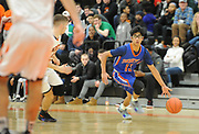 Newton South senior Salman Cheema brings the ball up the court during the game against Newton North at Newton North, Dec. 27, 2018.   [Wicked Local Photo/James Jesson]