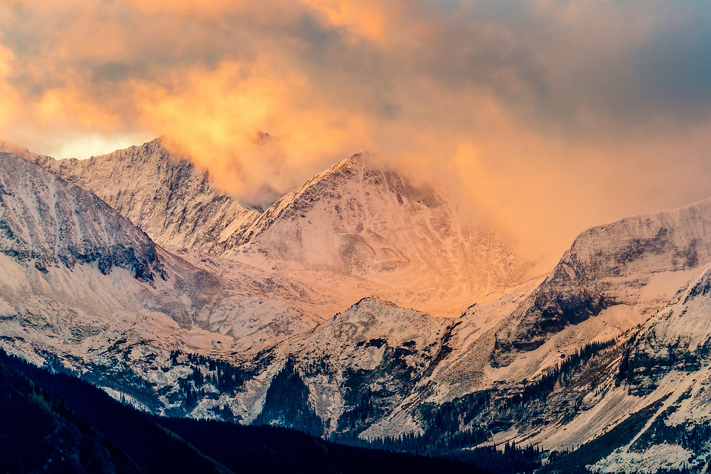 The clouds of a clearing autumn storm near Telluride highlight the drama of the San Juan Mountain Range.
