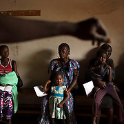 Mothers wait to have their children examined at a Medecins Sans Frontieres (MSF) clinic in a camp for internally displaced persons (IDPs) at the airport of the capital Bangui January 18, 2014.