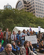 """Seattle, WA, USA - Oct.12,2011 - Surrounded by bank buildings and office towers in Seattle's Westlake Park, students from several colleges and universities join """"Occupy Seattle"""" events, part of """"Occupy Wall Street"""" gatherings in several U.S. cities. Schools include the University of Washington, Seattle Central Community College, Cornish College of the Arts and others. The building owned by Washington Mutual Bank before its collapse is seen above at left."""