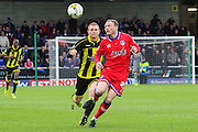 Burton Albion forward Stuart Beavon and Oldham defender Brian Wilson challenge for the ball during the Sky Bet League 1 match between Burton Albion and Oldham Athletic at the Pirelli Stadium, Burton upon Trent, England on 26 March 2016. Photo by Aaron Lupton.