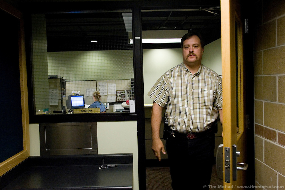 PINEDALE, WY - Under Sheriff Jim Whinnery at the new county jail, courthouse, and sheriff's office in Pinedale, WY, on August 5, 2005. The facility was built with tax revenue generated largely from the controversial development of Sublette County's natural gas fields. The energy boom, combined with a real estate boom, had brought added pressures to the county of 6400 residents and its small towns like Pinedale, the county seat, with 1400 residents.