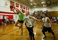"Haley Ryan of the ""Prescotts"" team and Dylan Tiede of the ""Wolfpac"" team on court 3 during the ""Ballin' for Bob"" Tournament for Hope at Laconia High School on Saturday.  (Karen Bobotas/for the Laconia Daily Sun)"