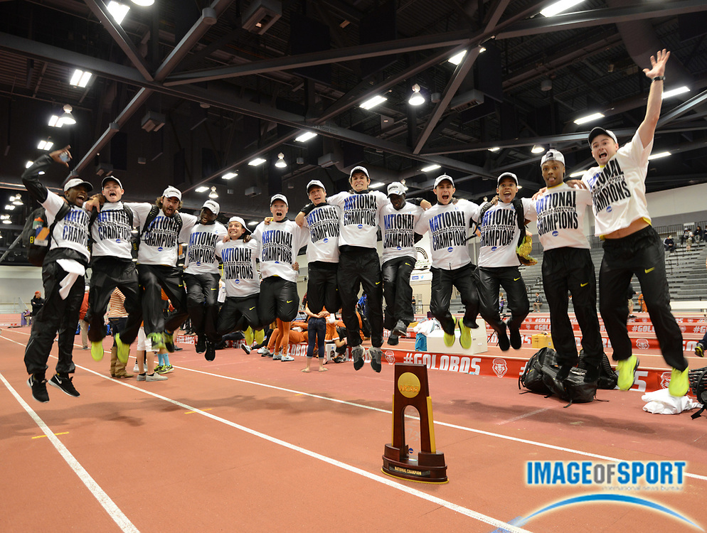 Mar 15, 2014; Albuquerque, NM, USA; Members of the Oregon Ducks mens team pose after winning the team title in the 2014 NCAA Indoor Championships at Albuquerque Convention Center.
