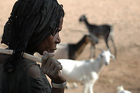 Niger, Agadez, Tidene, 2007. Grandmother maintains a strict order for the animals to drink. Everyone in the family will have a role in the watering..