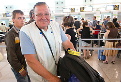 Coach Marjan Stimec and his son (L) at departure of team Slovenia at the end of European Athletics Championships Barcelona 2010, on August 2, 2010 at Airport, Barcelona, Spain. (Photo by Vid Ponikvar / Sportida)