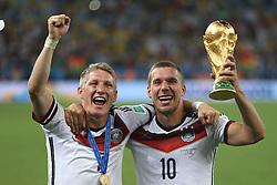 13.07.2014, Maracana, Rio de Janeiro, BRA, FIFA WM, Deutschland vs Argentinien, Finale, im Bild vl. Bastian Schweinsteiger (GER) und Lukas Podolski (GER) mit dem WM-Pokal // during Final match between Germany and Argentina of the FIFA Worldcup Brazil 2014 at the Maracana in Rio de Janeiro, Brazil on 2014/07/13. EXPA Pictures © 2014, PhotoCredit: EXPA/ Eibner-Pressefoto/ Cezaro<br /> <br /> *****ATTENTION - OUT of GER*****