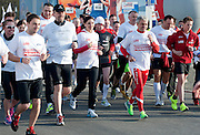 Trainers and athletes of Special Olympics attend a 3330 meters run one day before Warsaw Orlen Marathon on April 20, 2013..The mission of Special Olympics is to provide sports training and athletic competition for children and adults with intellectual disabilities...Poland, Warsaw, April 20, 2013..Picture also available in RAW (NEF) or TIFF format on special request...For editorial use only. Any commercial or promotional use requires permission...Photo by © Adam Nurkiewicz / Mediasport
